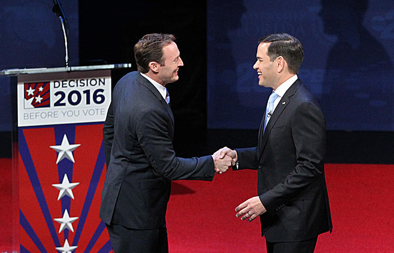 Incumbent U.S. Senator Marco Rubio shake hands with U.S. Representative Patrick Murphy at the second debate at Broward College in Davie on October 26, 2016.