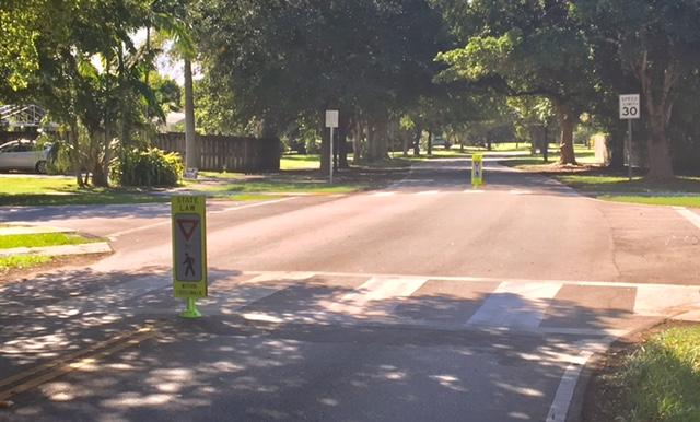 """""""Yield to pedestrians in crosswalk"""" signs have been brought in to replace two stop signs that were removed from the intersection of Southwest 148th Drive and 82nd Avenue in Palmetto Bay."""