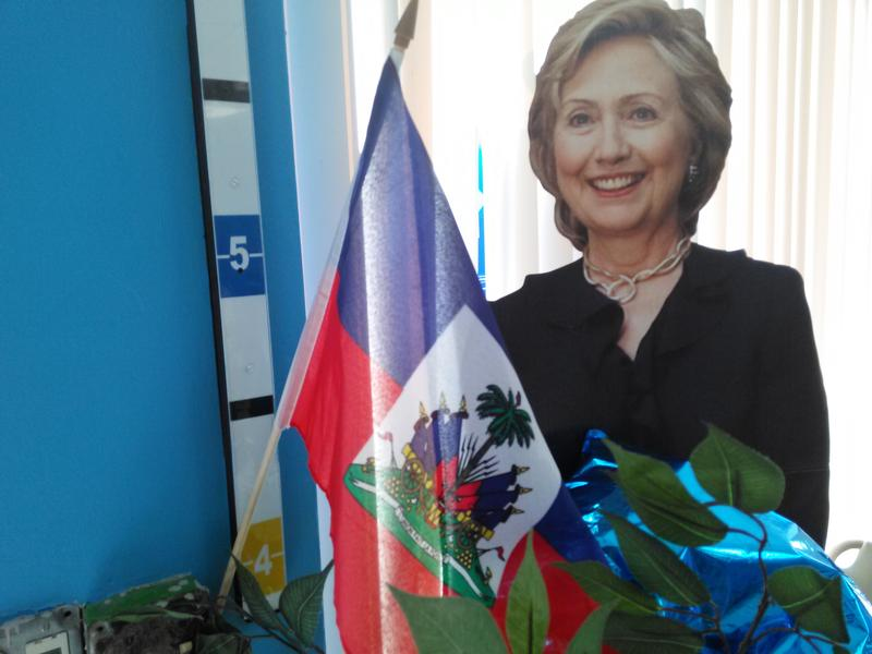 In an effort to court Haitian-American voters, Hillary Clinton opened a campagn office in Little Haiti where voters are welcomed by a cutout of the candidate and a Haitian flag.