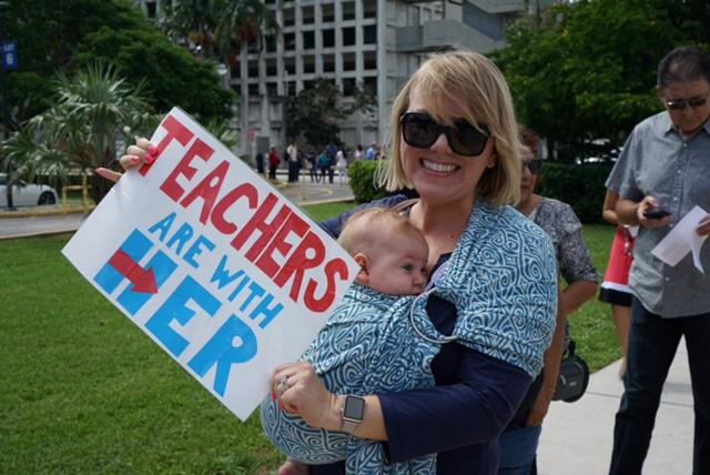 Public school teacher Lauren Schuster decided to go to the Hillary Clinton rally because she is concerned about further cuts in public schools if Donald Trump wins.