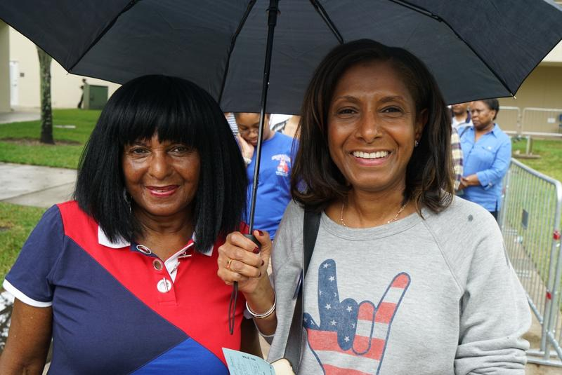 Jean Johnson (right) and her mother Barbara Harris (left) stood patiently under the rain for more than half an hour to make it into the Arena.
