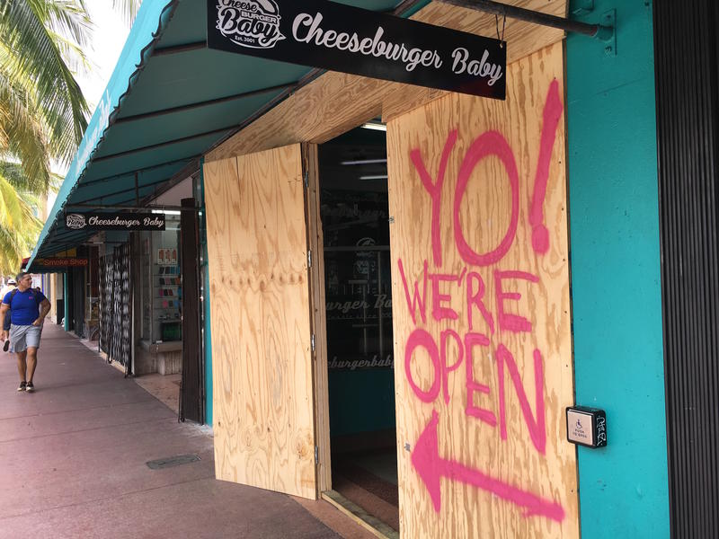 Employees at Cheeseburger Baby on South Beach spent half a day putting up plywood to protect the restauraunt in the face of Hurricane Matthew.