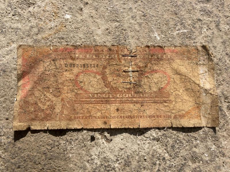 This bill was the first received in change by a WLRN reporter on arrival to Haiti to cover Hurricane Matthew. Even the bill, worth 20 Gourdes, or about 30 cents, has a story to tell about the travails of the Haitian economy.