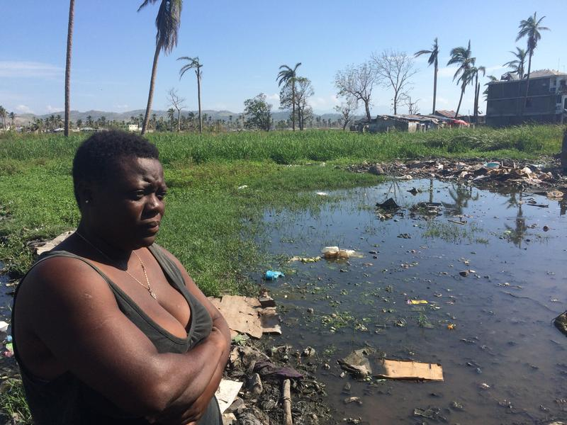 Antonine Germain at the edge of Lasinal, beside a water source she says people usually use for laundry and bathing.