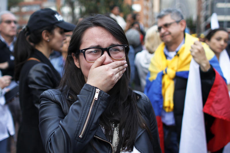 "A supporter of the ""Yes"" cries as she follows on a giant screen the results of a referendum to decide whether or not to support the deal in Bogota, Colombia, Sunday, Oct. 2, 2016."