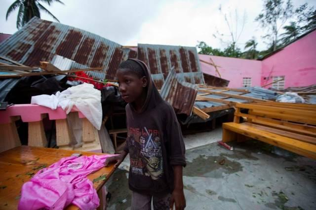 A boy stands by a church destroyed by Hurricane Matthew in Saint-Louis-Sud in southwest Haiti.