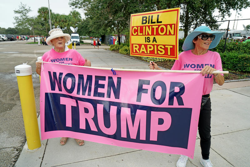 Diane Krishner and Linda Polsney from Fort Lauderale carry a 'Women for Trump' sign outside of the South Florida Fair Expo Center in West Palm Beach on October 13, 2016.