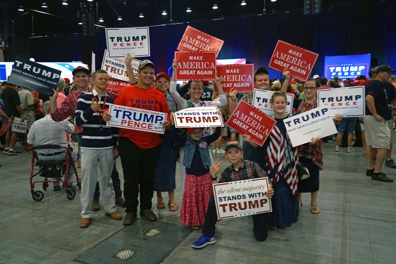 Young and old supporters gathered holding campaign signs before Donald Trump spoke at the rally on October 13, 2016.