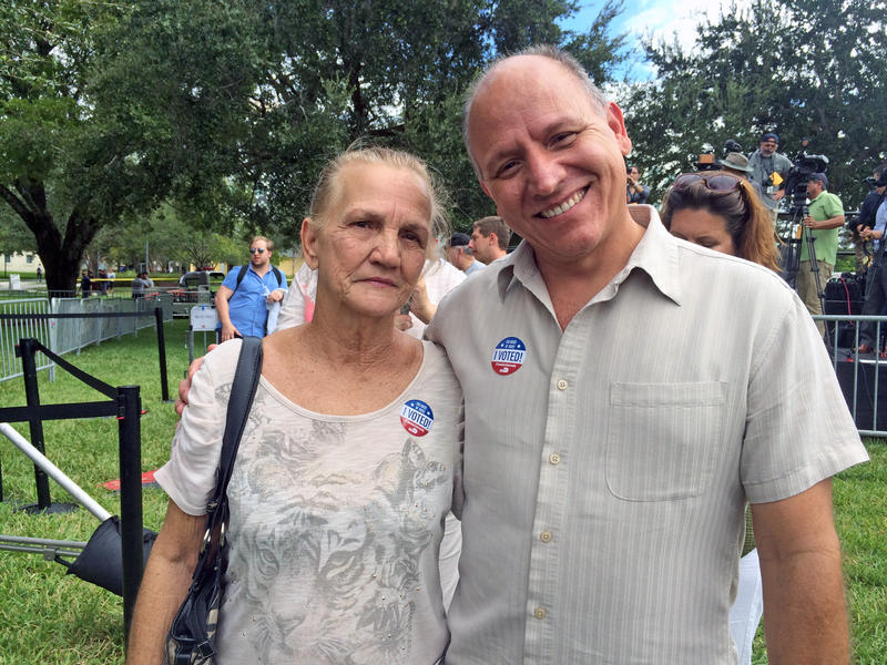 Mercedes Rodriguez, a Democrat, stands with her son Osmel Rodriguez, a Republican turned independent, at the Tim Kaine rally at Florida International University on October 24, 2016.