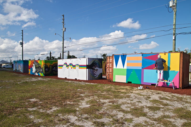 Local artists paint shipping containers in a vacant West Palm Beach lot on Thursday, Nov. 10.