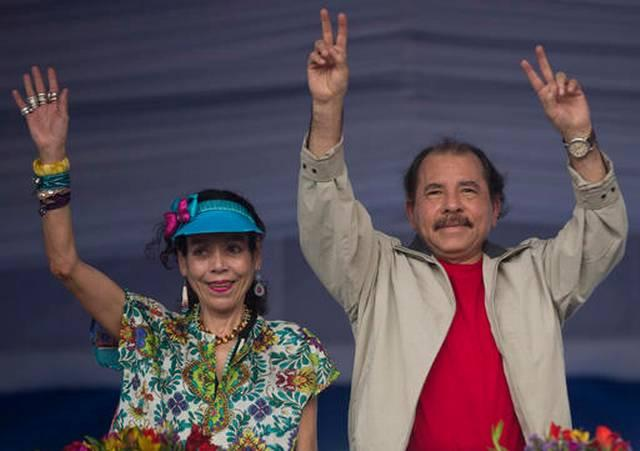 SANDINISTA STRONGMAN Nicaraguan President Daniel Ortega (right) campaigning in Managua this year with his wife and running mate Rosario Murillo.