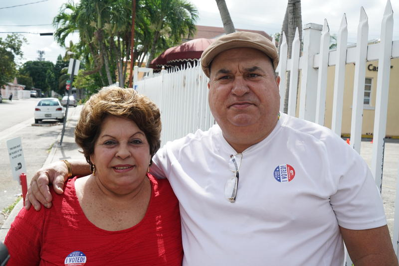 Leida Gonzalez (left) and Oscar Rubio (right), both voters registered at precinct 669 in Little Havana, said having more Spanish speakers working at the polls would improve the experience.