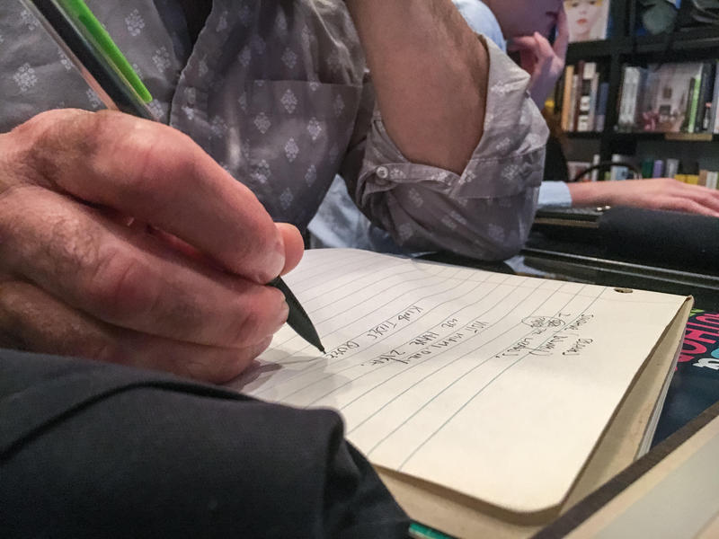 Kenneth Wright scribbles some short stories in his notebook during the Miami Book Fair and WLRN's First Draft writing workshop at the Café at Books & Books Adrienne Arsht Center on October 24, 2016.