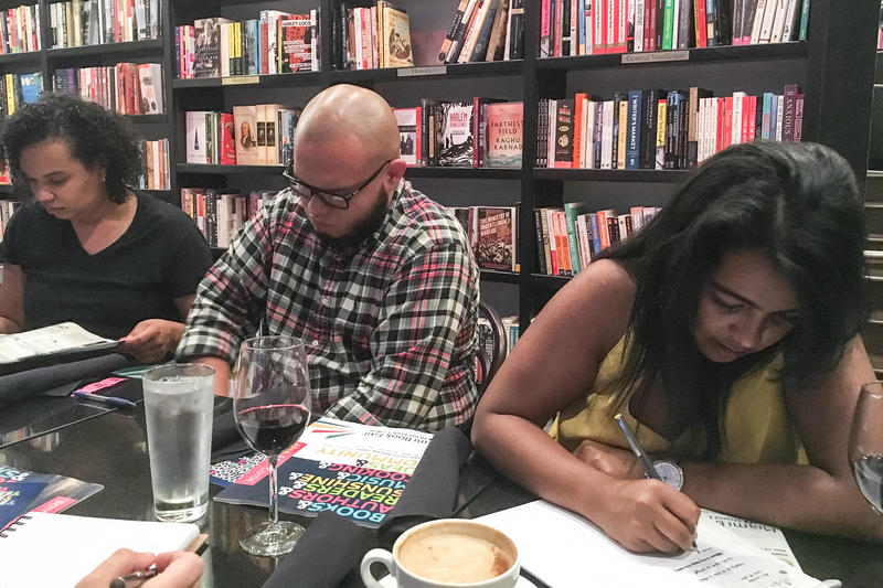 Participants take 15 minutes to think about their six word stories and write them down at the Miami Book Fair and WLRN's First Draft writing workshop at the Café at Books & Books Adrienne Arsht Center on October 24, 2016.