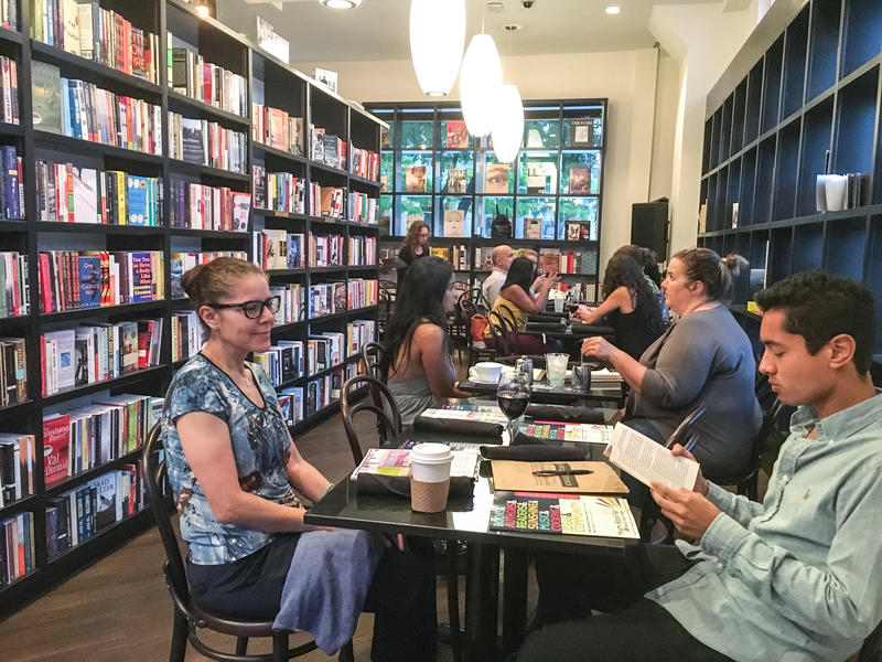 Participants contemplating what they want to write about in their very short stories at the Miami Book Fair and WLRN's First Draft writing workshop at the Café at Books & Books Adrienne Arsht Center on October 24, 2016.