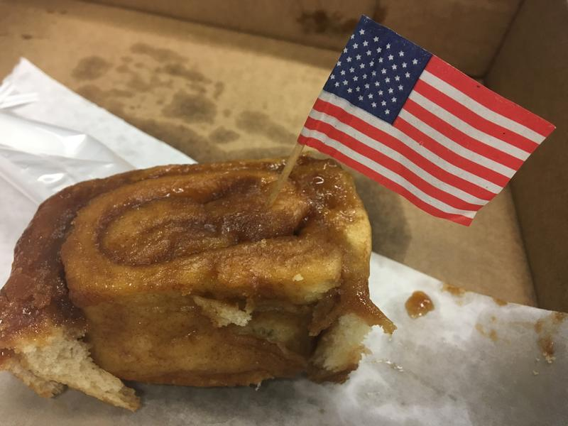 One of the Knaus Berry Farm cinnamon rolls adorned with an American flag toothpick.
