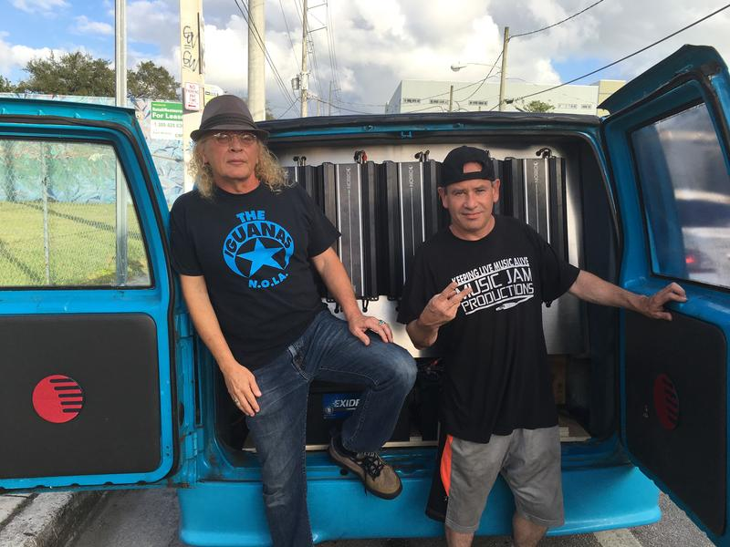 Neil Case, left, and Billy E, right, with the sky-blue bass van.