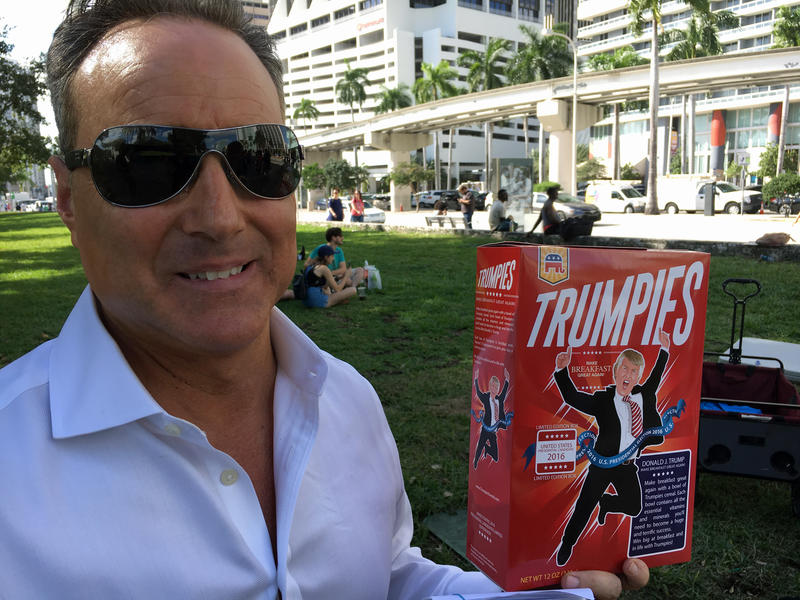 Santiago Cueto shows off a box of Trumpies outside a Donald Trump rally at Bayfront Park on November 2, 2016.
