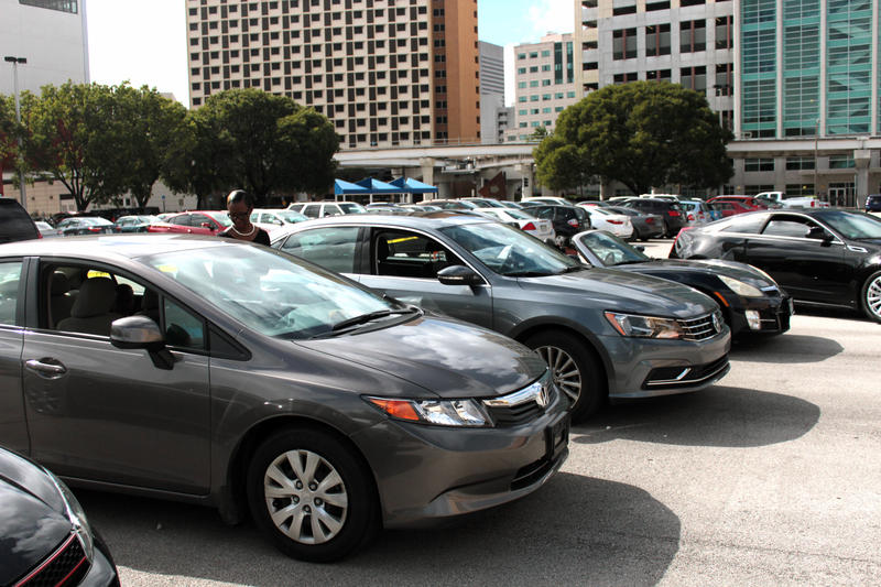 Cars participate in demonstration of Symphony No. I-95 in a Miami Dade College parking lot on Nov. 29, 2016.