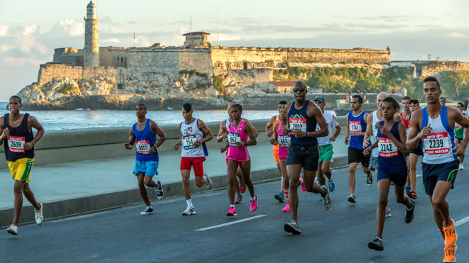 Runners, including Americans, take in the seaside Malecon during last year's Havana Marathon, or Marabana.