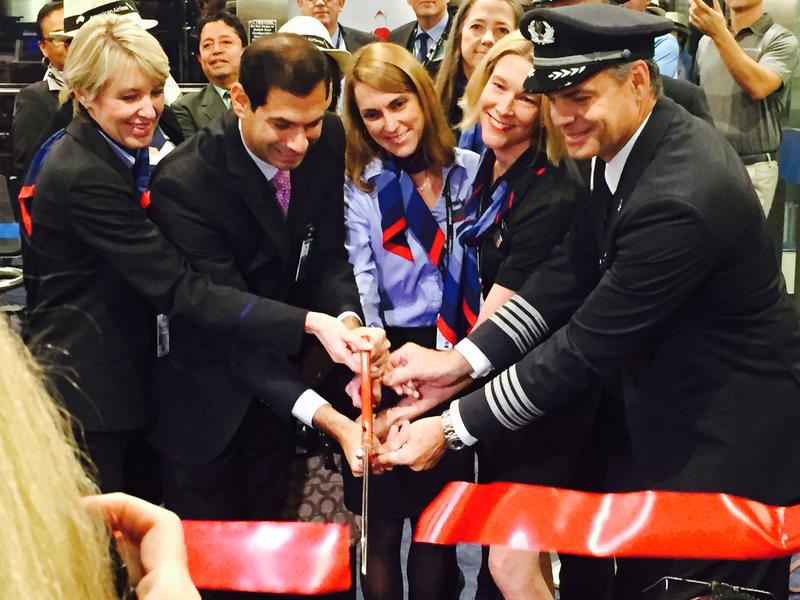 American Airlines executives and crew cut a ribbon at Miami International Aiport Monday morning before the first commercial flight from Miami to Havana in more than half a century.