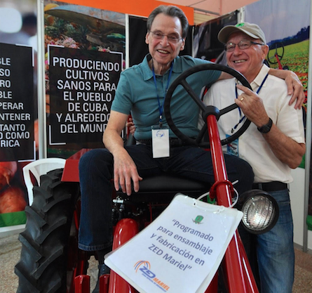 "Cleber partners Saul Berenthal (left) and Horace Clemmons with one of their ""Oggun"" tractors at an agricultural exhibition in Havana last March."