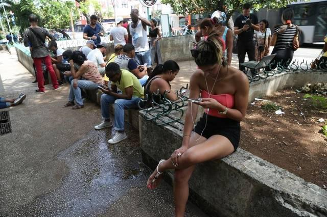 Cubans try to get online at a WiFi hotspot in Havana.