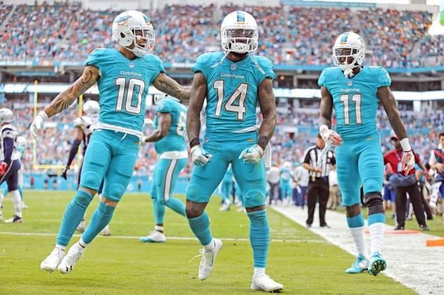 Jarvis Landry, center,  was fired up after catching his fourth and final touchdown pass of the season.