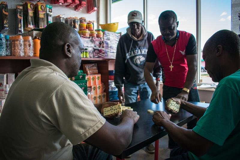 Kali Duffy, captured a group of Haitian men playing dominoes in Little Haiti. YoungArts photography finalists documented the neighborhood on a recent trip.