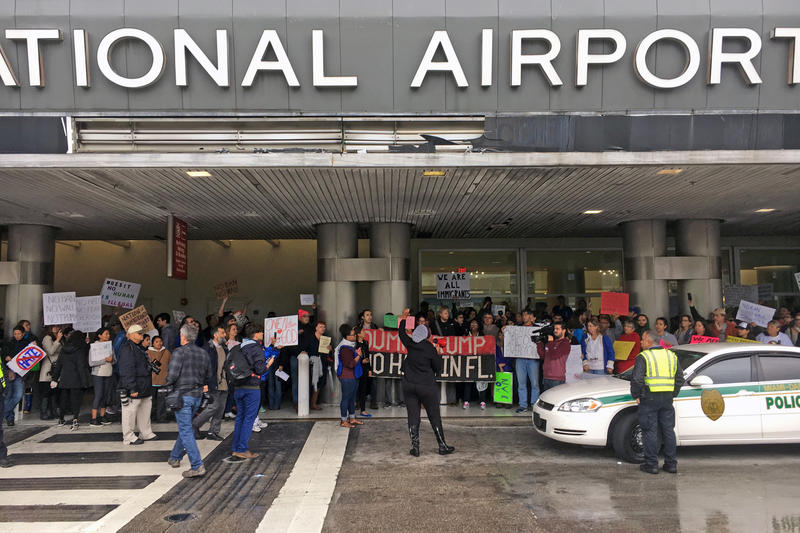 Hundreds of people rallied against Trump's executive orders on immigration at Miami International Airport on Sunday, Jan. 29, 2017.