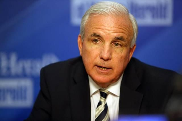 Miami-Dade Mayor Carlos Gimenez is under fire from local immigration activists for reversing a four-year-old county policy and bowing to President Trump's demand on detaining undocumented immigrants.