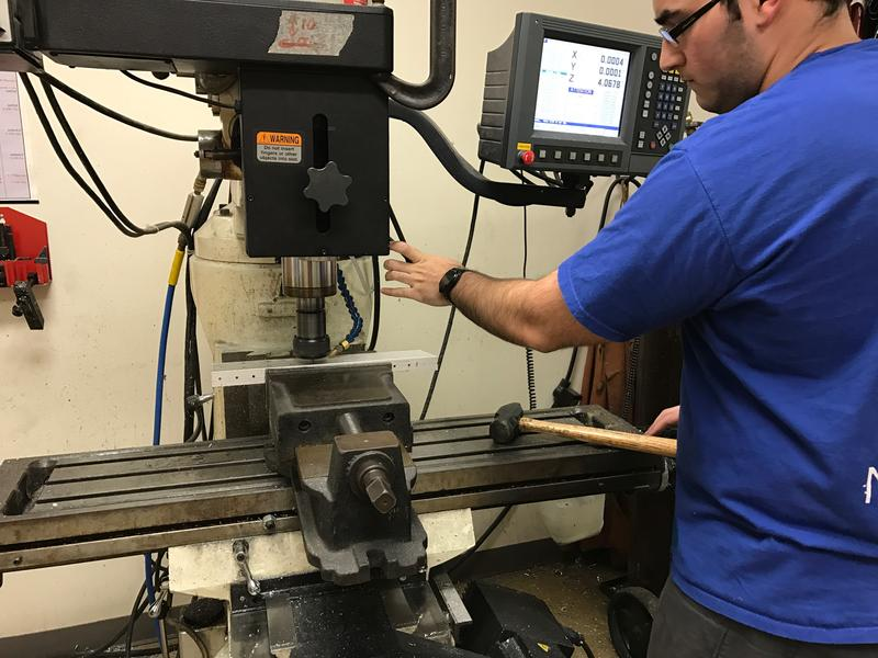 Marcos Villa, an alumnus of the program, and current Florida International University student, is helping shape some of the pieces for the main robot.