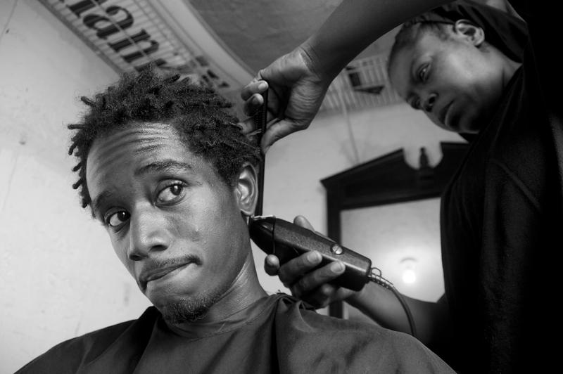 Debresia LeSane runs a barbershop from her home. Pompano Beach, 2016.
