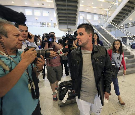 Carlos Ariel Amigo, left, arrives in Miami as part of a group of Cuban doctors who were allowed to enter the United States through Miami International Airport on Feb. 6, 2017.