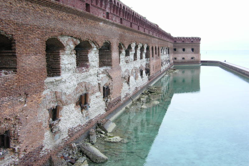 Corrosion from iron shutters led to the failure of the fort's bricks, leaving its interior coral concrete exposed.