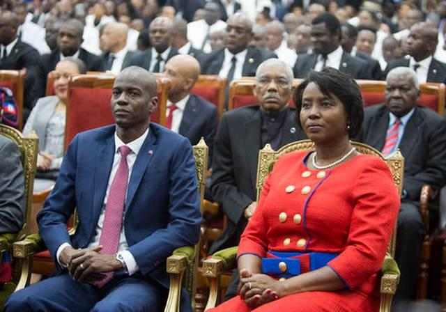 New Haitian President Jovenel Moise (left) with his wife Martine during his swearing in ceremony in Port-au-Prince Tuesday.