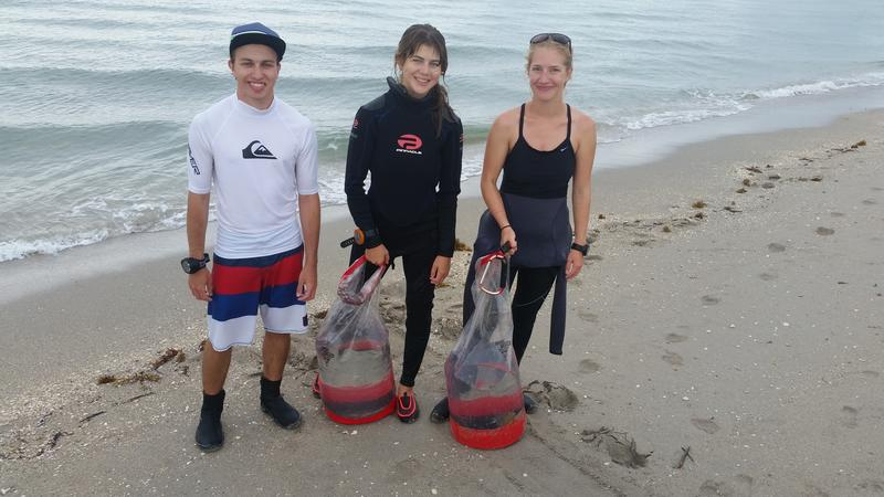 From left, REEF marine conservation interns Tom Hyduk and Emily Volkmann joined REEF's invasive species specialist Emily Stokes to remove a one spot rabbitfish from the water off Broward County.
