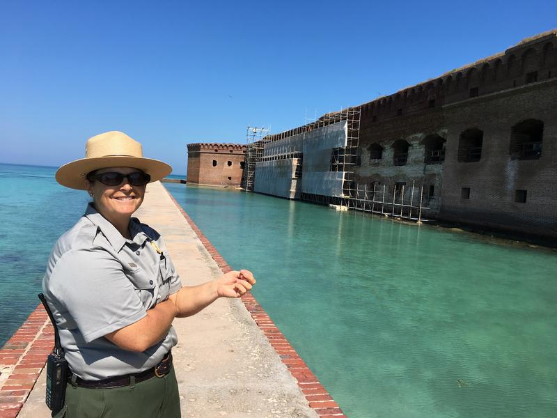 Kelly Clark, the cultural resources specialist at Dry Tortugas National Park, points out details of the restoration work.