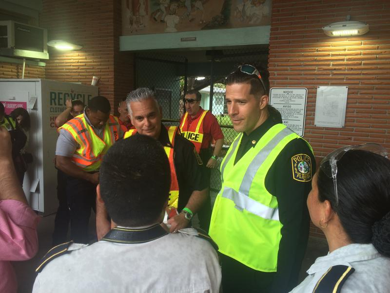 Guatemalan and Miami officers traded thoughts on the drill as they took shelter from the rain.