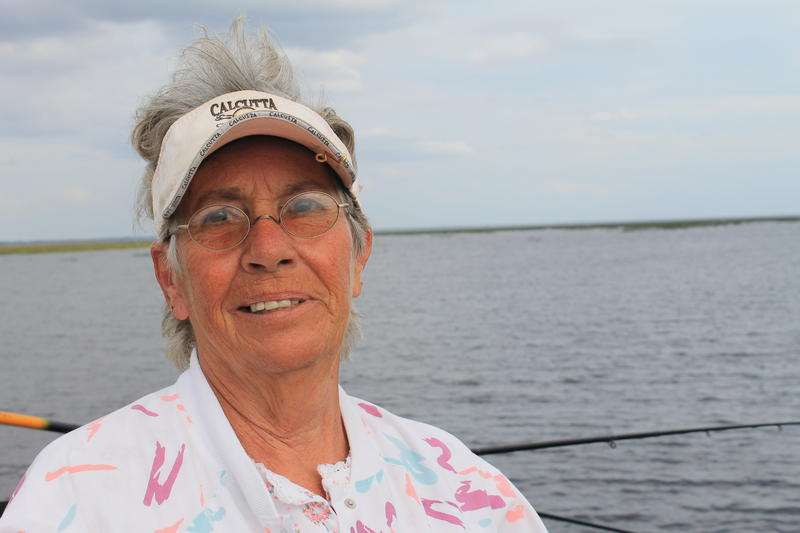 Allean Massie has fished on Lake Okeechobee's north shore for nine years. She remembers when the lake looked cleaner.