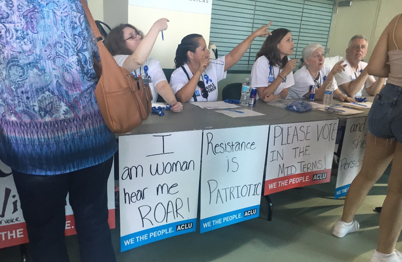 Volunteers give participants directions at ACLU's  People Power event at the University of Miami.