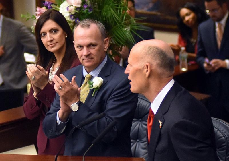 Speaker pro tempore Jeanette M. Nunez, R-Miami, and House Speaker Richard Corcoran, R-Lutz, applaud Gov. Rick Scott as he is welcomed to the Speaker's rostrum during opening session of the Legislature March 7, 2017.