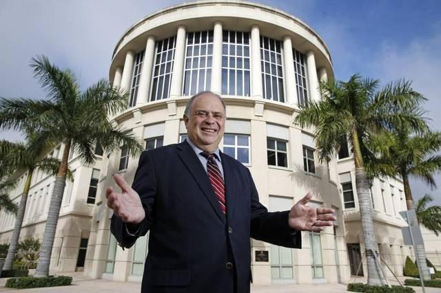 "Doral's founding mayor, Juan Carlos ""JC"" Bermudez, stands outside of City Hall."