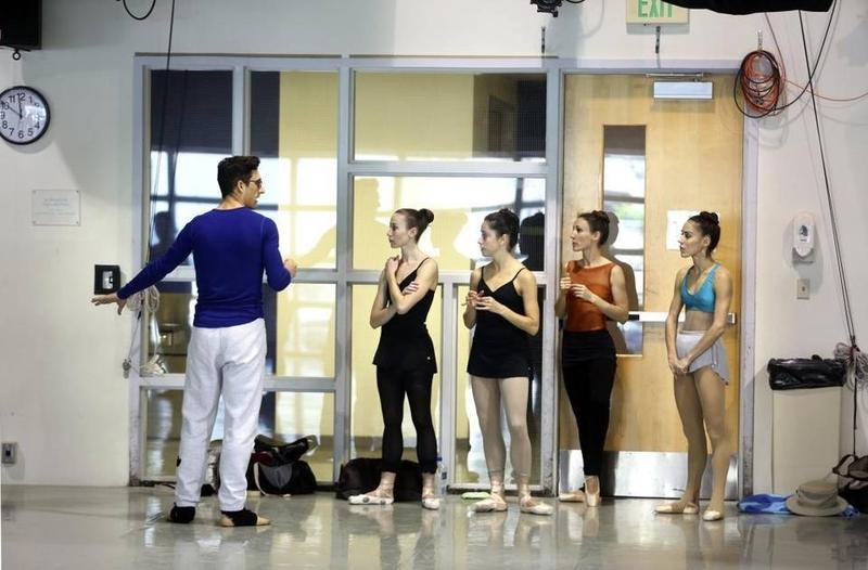 "Choreographer Justin Peck rehearsing ""Heatscape"" at the Miami City Ballet studios in 2014, with (left to right) Nicole Stalker, Leigh-Ann Esty, Tricia Albertson and Patricia Delgado"