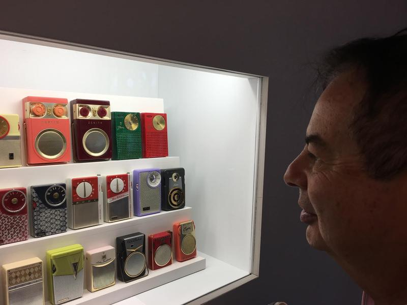 Harvey Mattel looks at some of his transistor radios on display at The Wolfsonian-FIU. The exhibit is part of RadioFest, an all day celebration of radio at the museum.