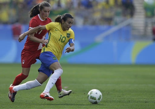 Brazil's Marta, right, and Canada's Jessie Fleming compete for the ball during the bronze medal match of the women's Olympic football tournament, in summer 2016.