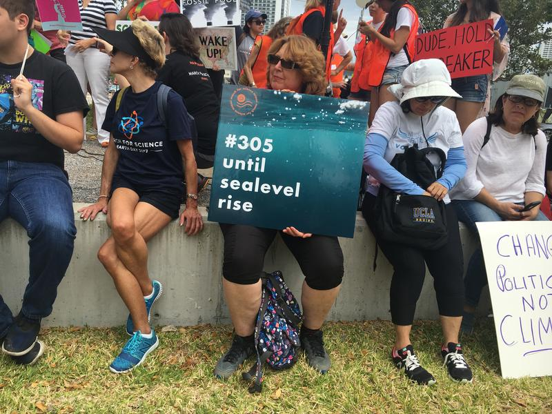 "Professor Susan Jacobson from Florida International University holds up sea level rise sign at ""March for Science"" Miami rally."