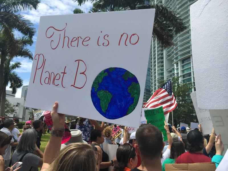 "Signs addressing climate change were held up high at ""March for Science"" Miami in front of Musuem Park."