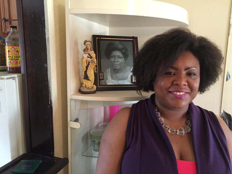 Haitian TPS holder and TV host Farah Larrieux at home in Miramar with a photo of her mother, who died in Haiti two years ago.