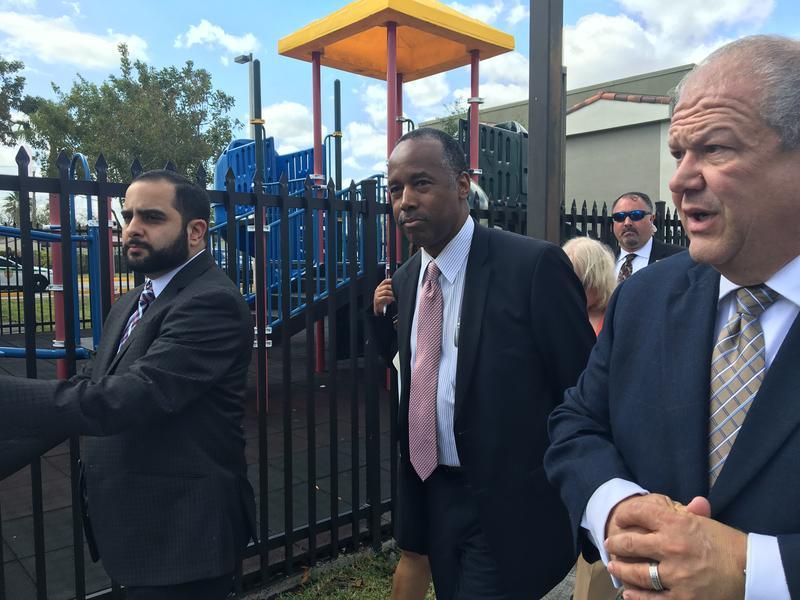 HUD Secretary Ben Carson, center,  visits Hoffman Gardens in Hialeah.